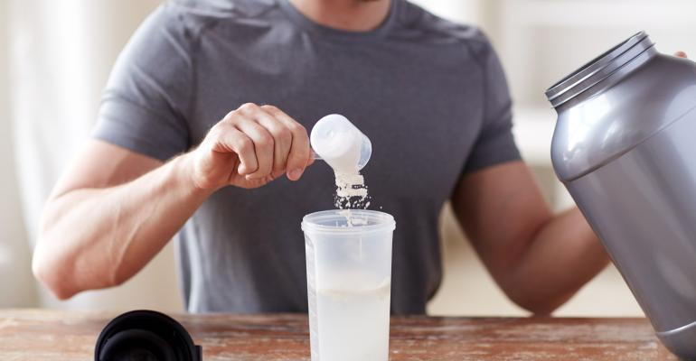 Man making a protein shake