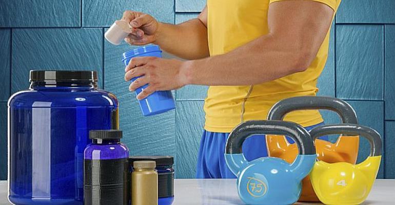 Athlete mixing amino, protein supplements