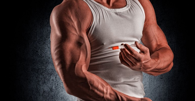 Bodybuilder injecting substance