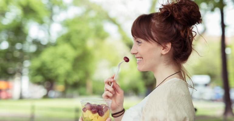 Woman Eating Portable Fruit