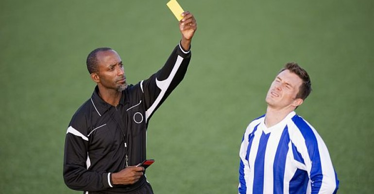 Referee giving a yellow card warning