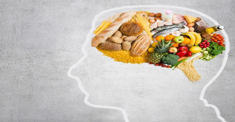 fruit and veggies as brain in profile silhouette