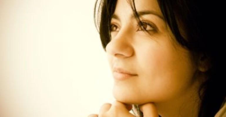 pensive hopeful woman