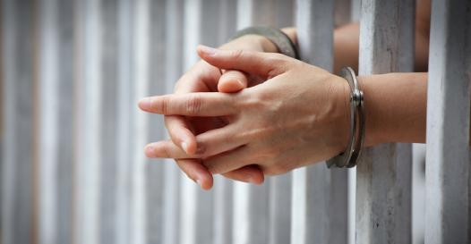 jail handcuffed hands.jpg